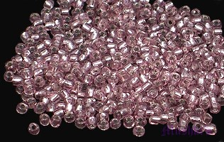 Amethyst silver-line Indian glass seed bead - click here for large view